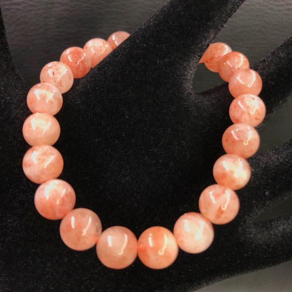 Bracelet perles en pierre soleil naturelle 8mm de norv ge for Pierre de placage exterieur